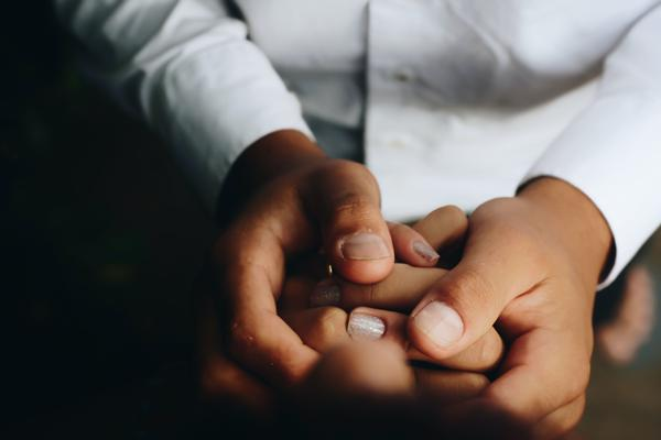 One person holding another persons hand