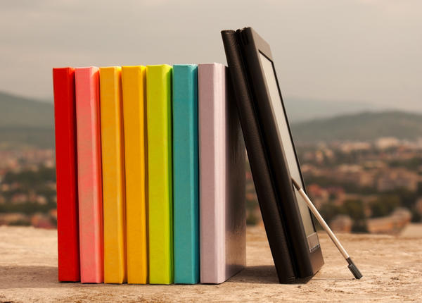 row of books with electronic book reader