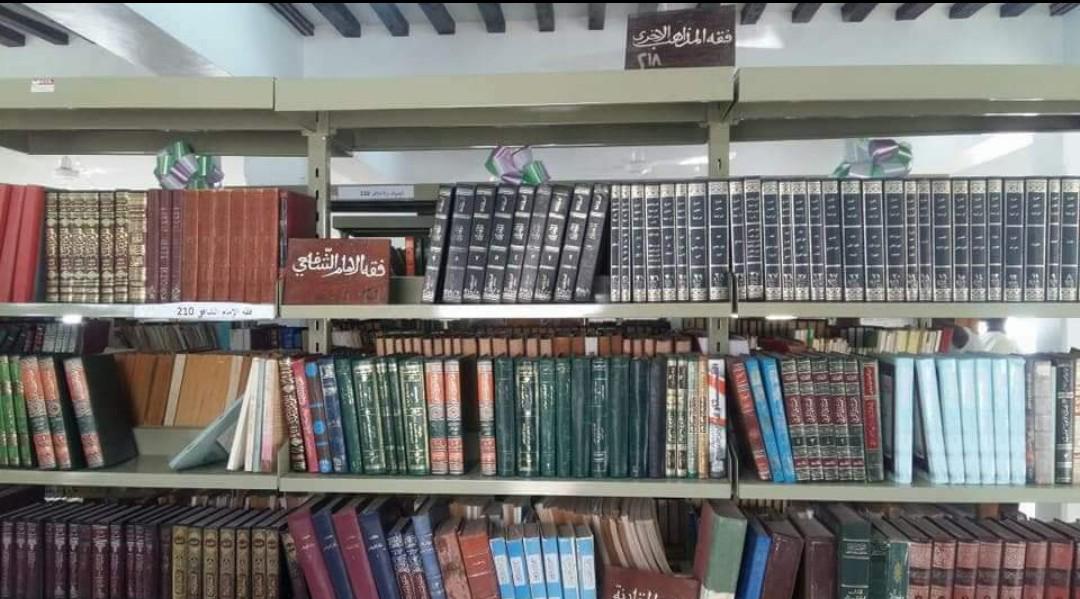 Photo of fiqh books on shelf, Riyadha, Lamu