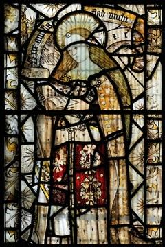 Stained glass picture of a holy woman reading