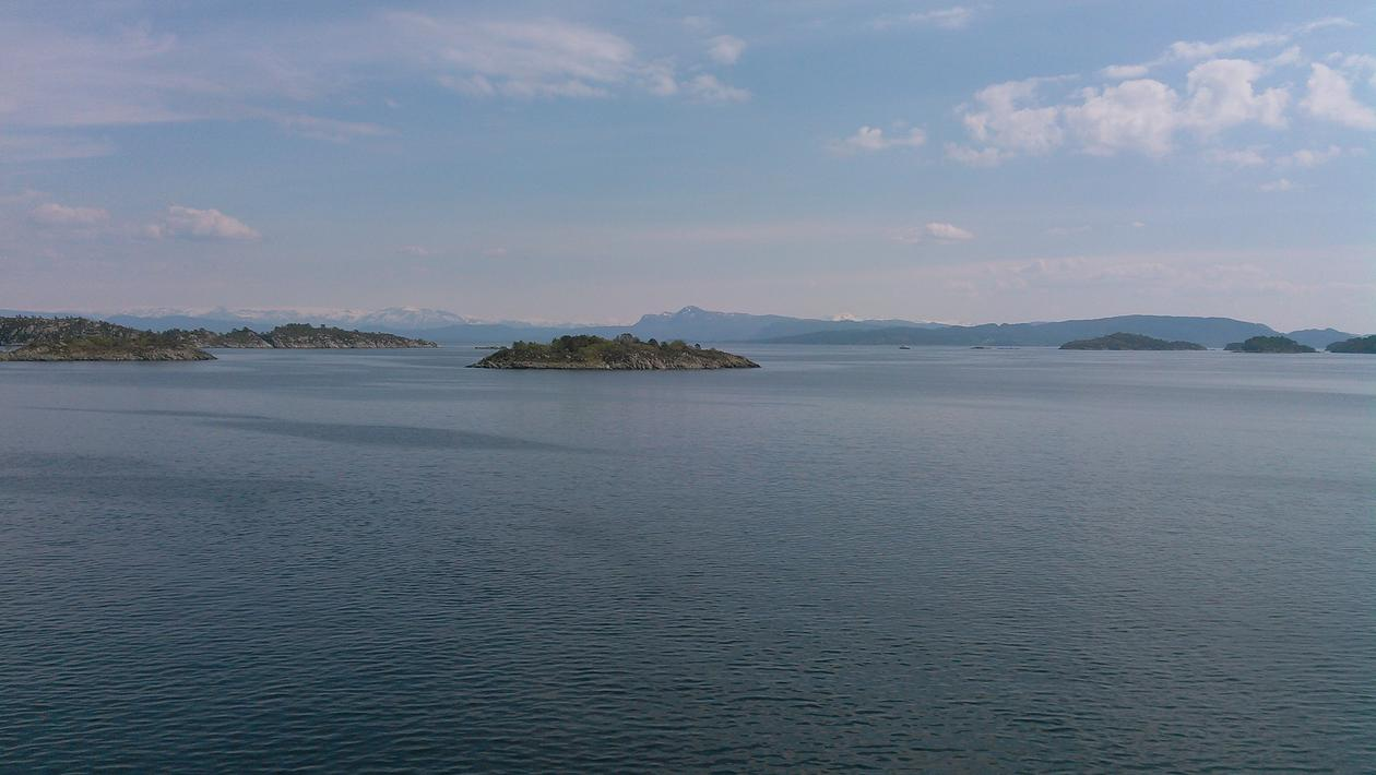 View over a fjord towards mountains
