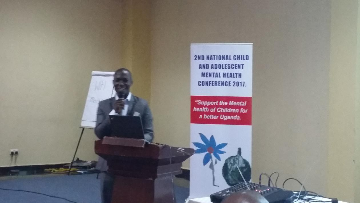 Michelle Mukochi, one of the PROMISE Saving Brains and SeeTheChild-mental child health in Uganda clinical staff, presenting from his own clinical research