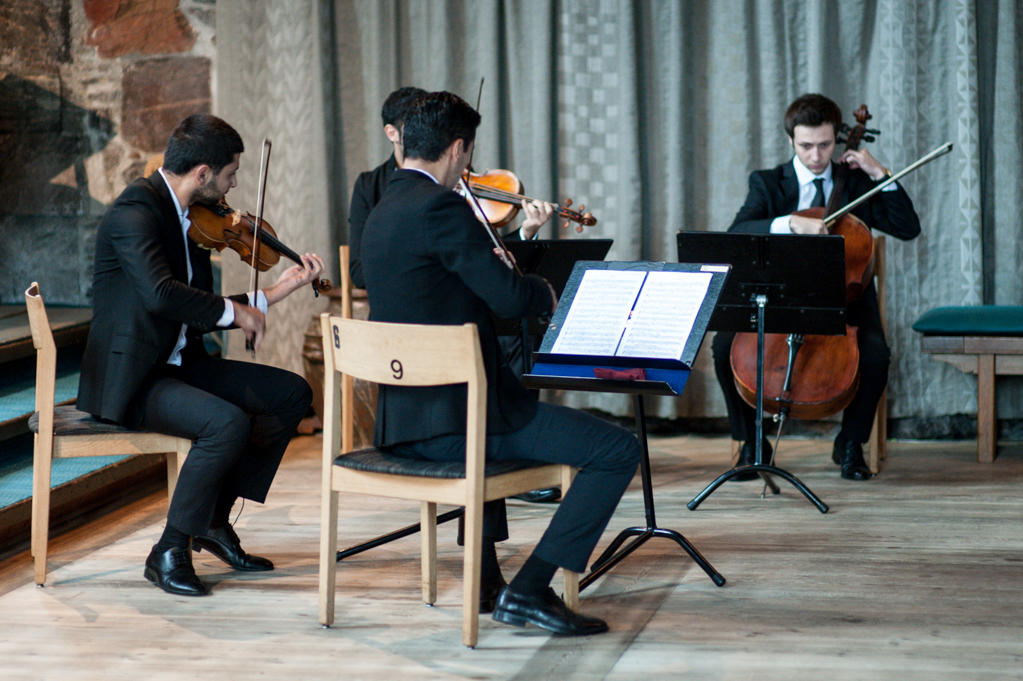 Students from the Grieg Academy performing for the guests and new doctors at Håkonshallen during the doctor promotion in August 2013.