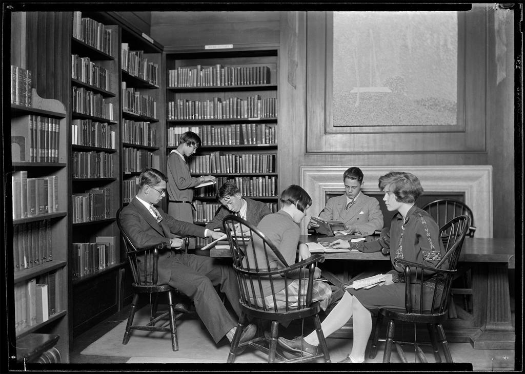 Black and white photo of students studying together at a table
