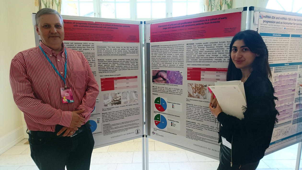 Andrey and Gayanna standing in front of their posters.
