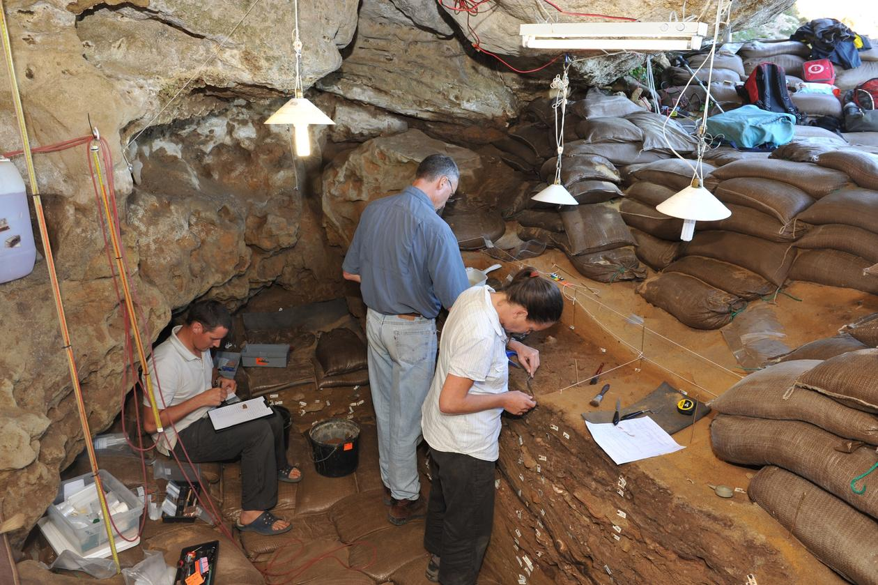 Professor Christopher Henshilwood and members of the TRACSYMBOLS research team at work in Blombos Cave in South Africa's Western Cape region.