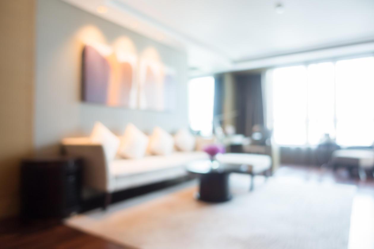 Blurry livingroom with white rug