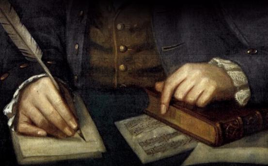 mann skirver med fjerpenn