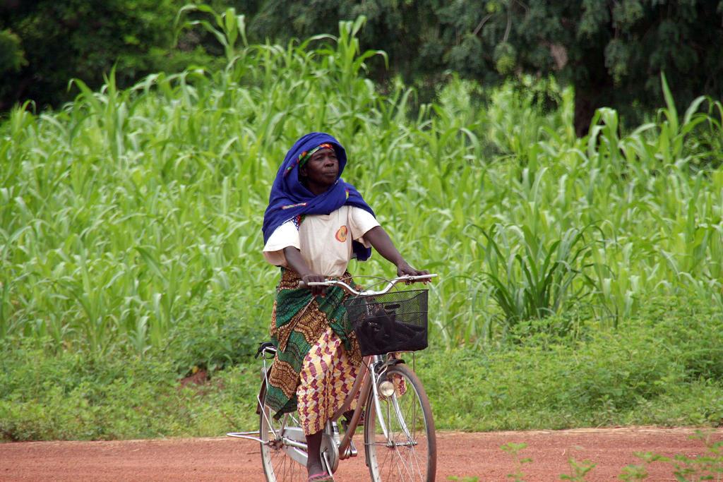 Woman on bicycle, Burkina Faso