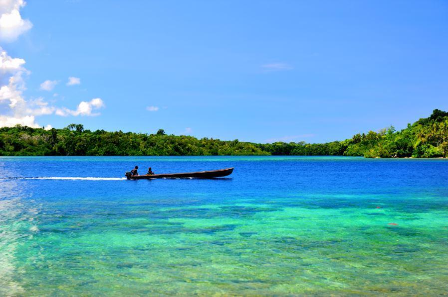 Boat crossing lagoon in Solomon Islands