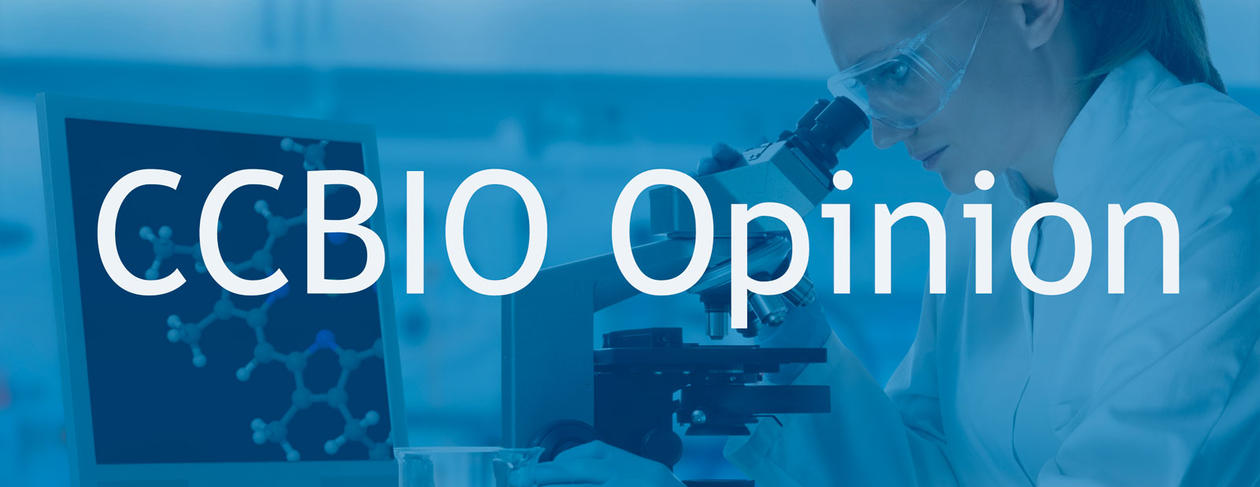 A scientist looking in a microscope as background, and the text CCBIO Opinion in front.