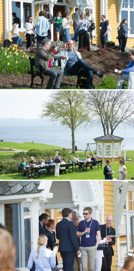 Audience at the CCBIO Annual Symposium gathered outside in breaks with fjord view at Solstrand.