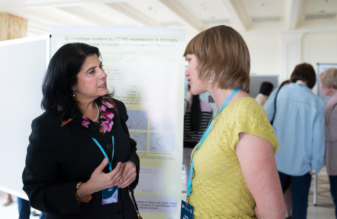 Marsha Moses from Harvard in conversation with one of CCBIO's young researchers, Monica Mannelqvist, at the poster exhibition.