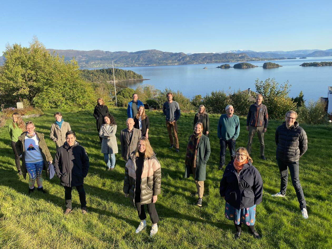 Group of people in front of fjord