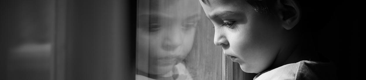 Child looking through window