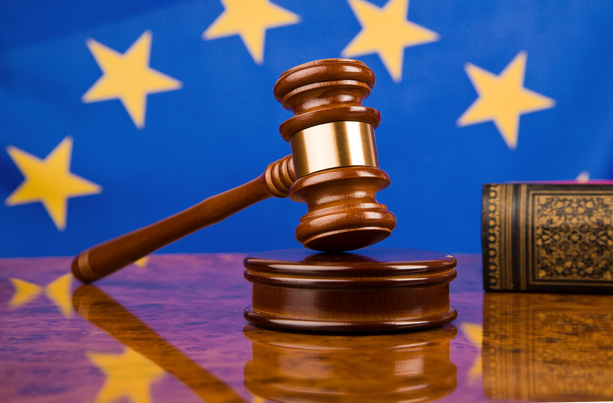 Stock photo of a gavel in front of the EU flag
