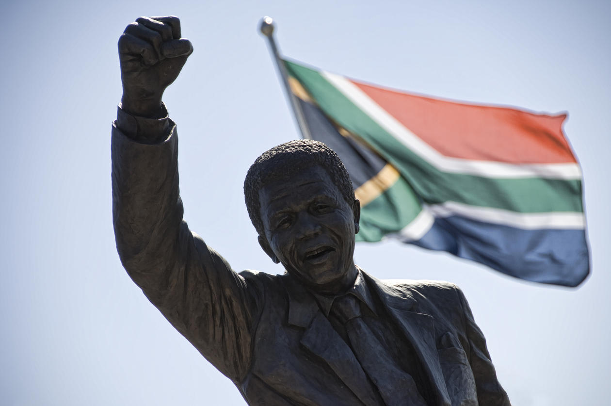 A statue of Nelson Mandela in front of the South African flag, used to accompany article on a democracy conference in Johannesburg 17-19 November 2014.