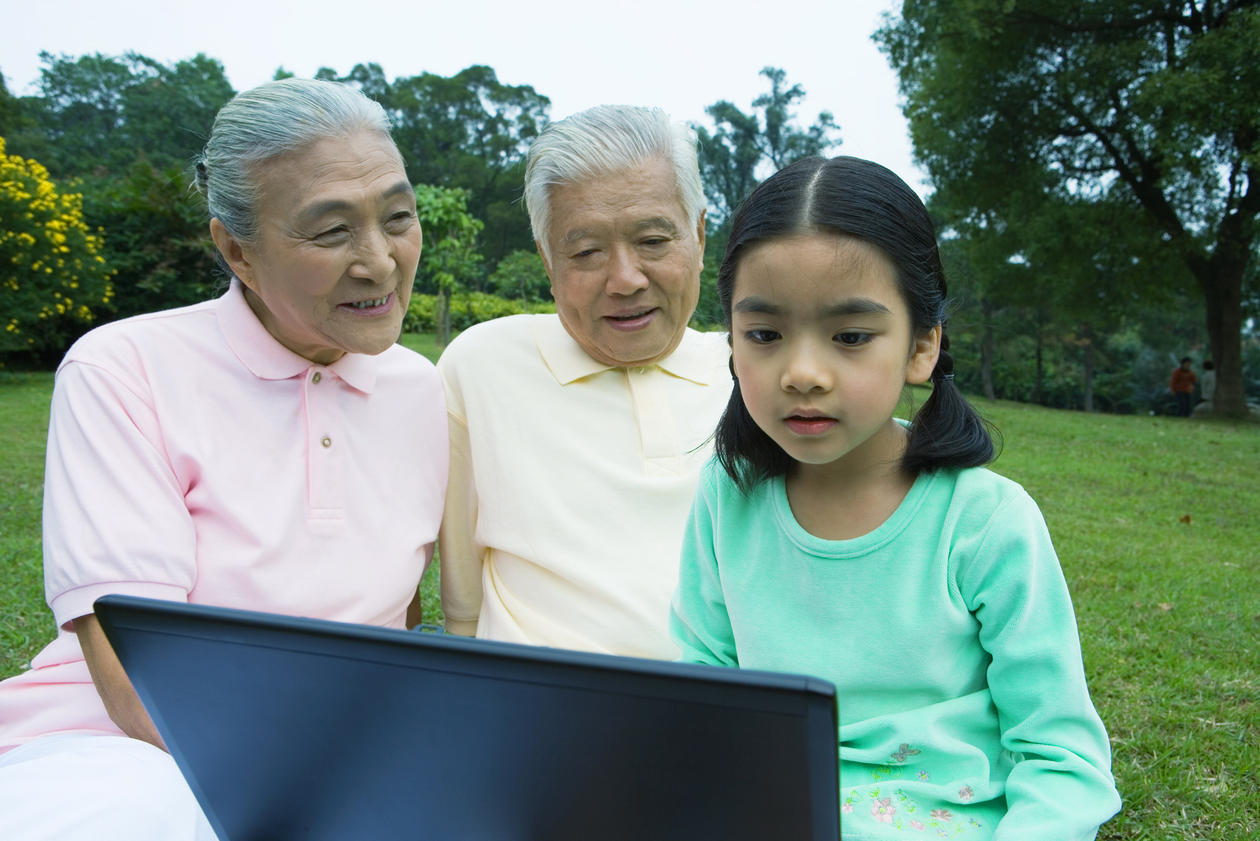 Chinese grandparents with their granddaughter, illustration photo about China's one-child policy.