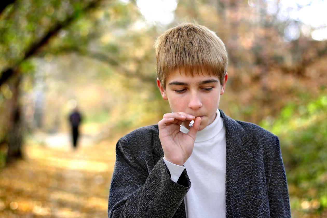 smoking adolescent boy