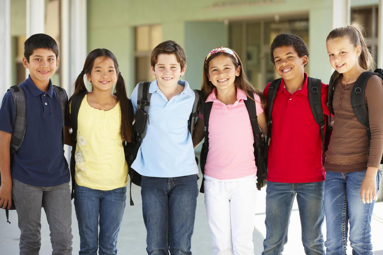 Six smiling school children