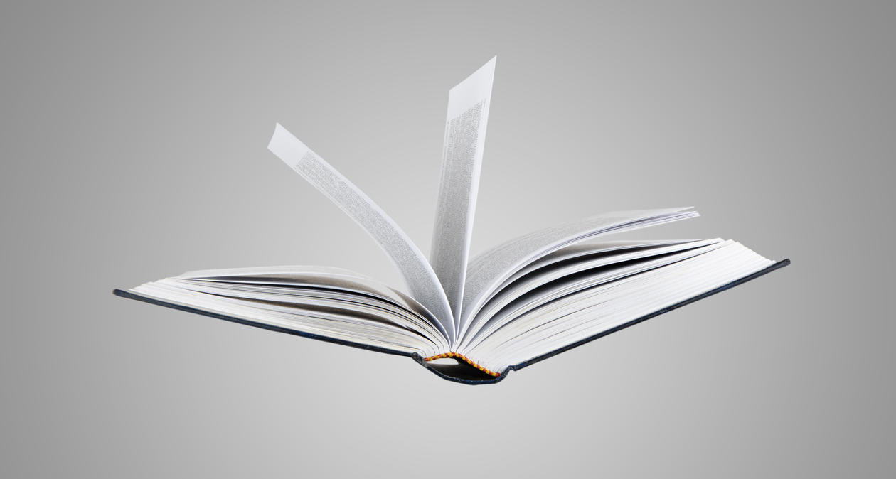 Image showing an open book flowing in mid-air