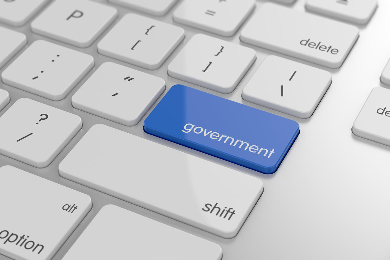 """Keyboard showing the shift key marked in blue with the imprint """"government"""". Used to illustrate news article about e-government."""