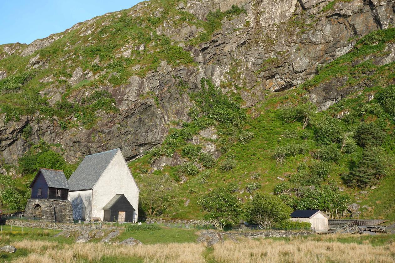 The Kinn project: Bornihelleren at Kinn lies in the slope just behind the church