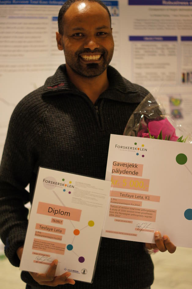 Leta Tesfaye with diploma and check.