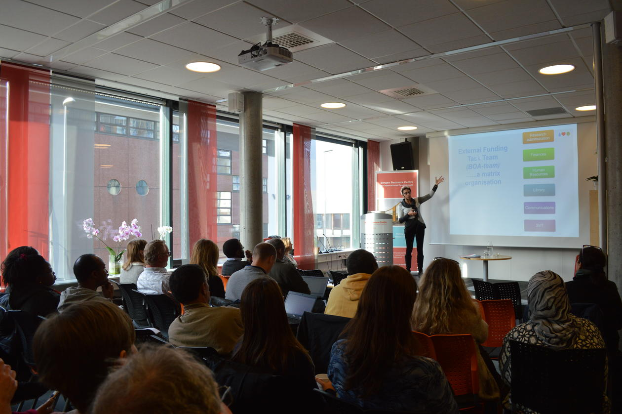 Audience attending seminar listening to presentation