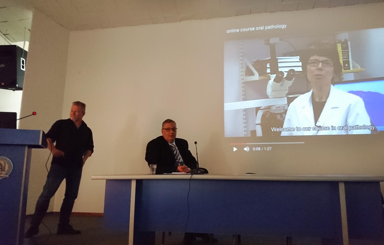 lecture in a classroom, showing a video.