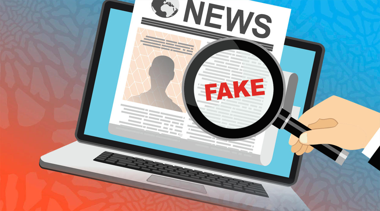 Illustration of a pc screen with a newspaper in it, and a magnifying glass with the text Fake News.