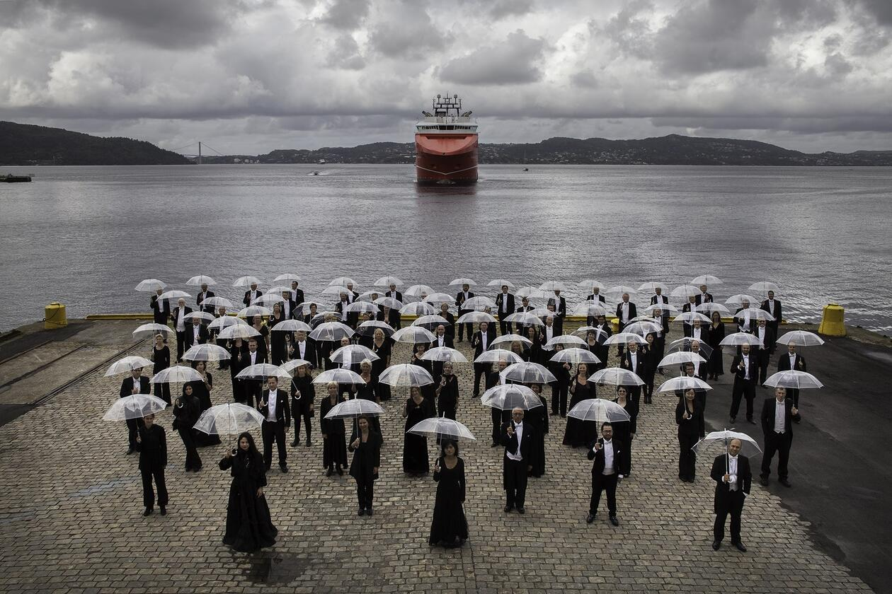 Members of the Bergen Filharmonic Orchestra with umbrellas
