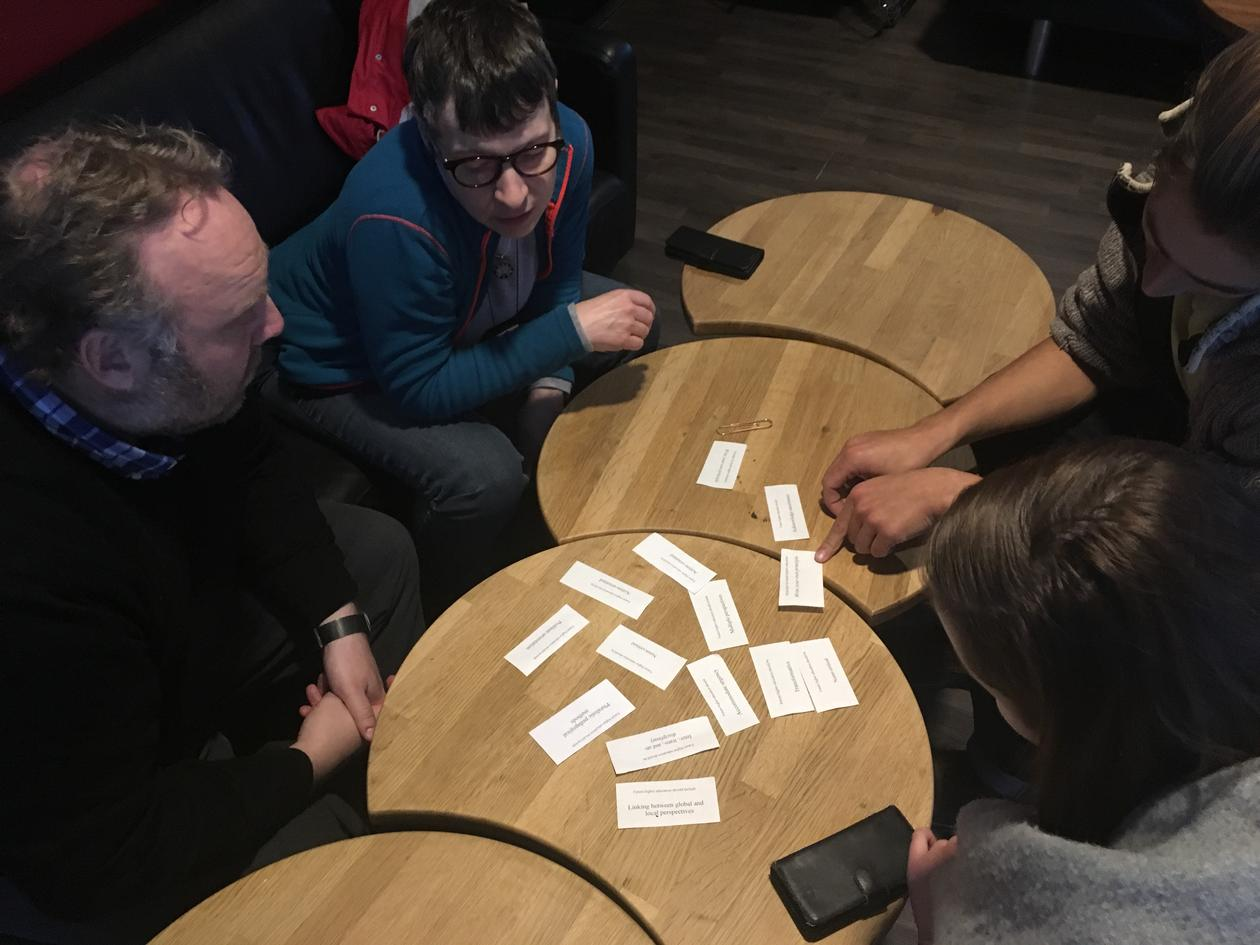 workshop with four people discussing