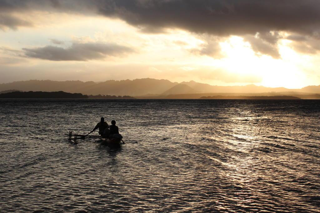 Pacific islands fishermen in a canoo