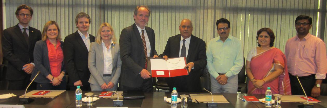 Professor Asbjørn Strandbakken and Vice Chancellor at the National Law University, Professor (Dr.) Ranbir Singh with the newly signed agreement.