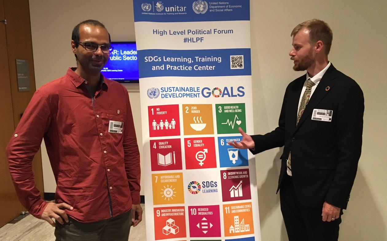 Siddharth Sareen (left) and Jakob Grandin from the University of Bergen outside Conference Room 5 in the UN building in July 2018.