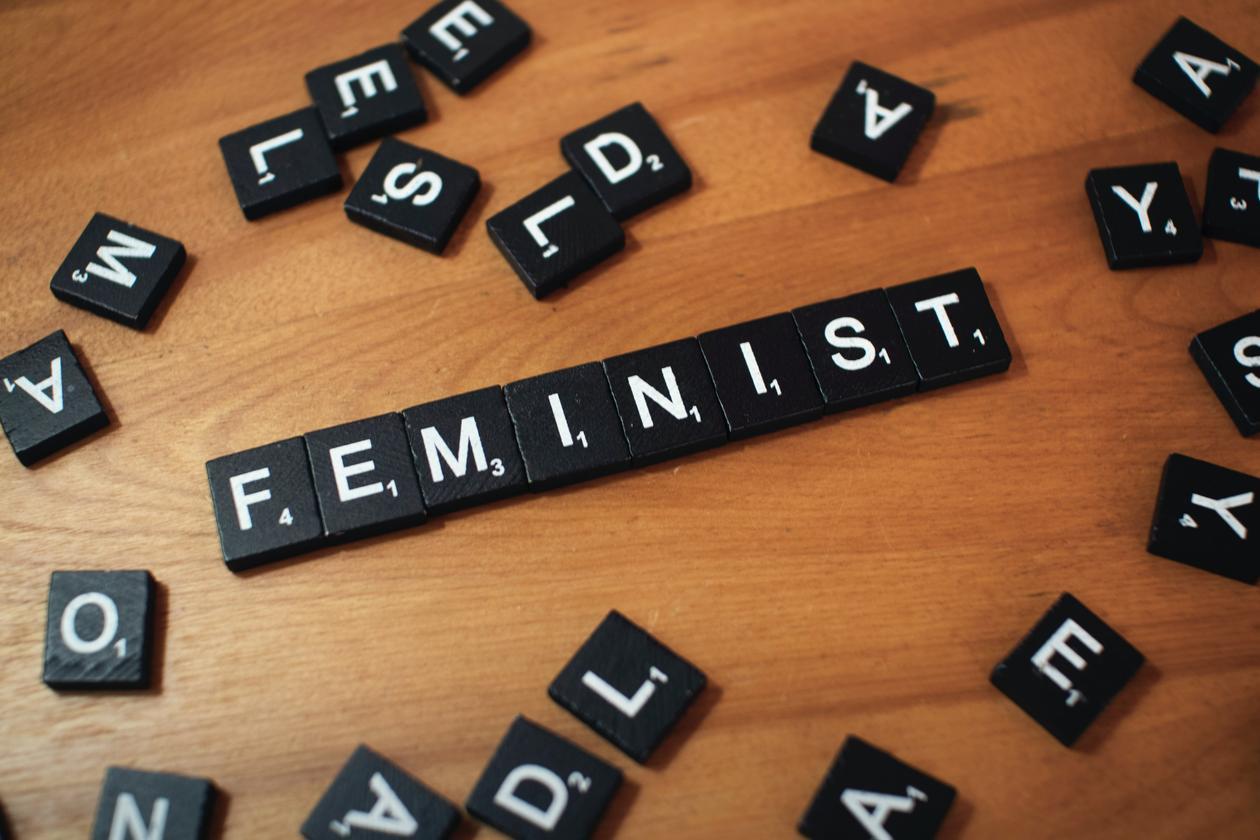 Scrabble tiles spelling out feminism