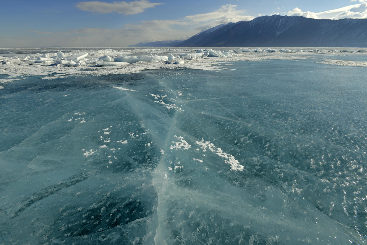 Endless blue ice on the frozen lake Baikal, Siberia, Russia, used to illustrate side event at UN on climate action.