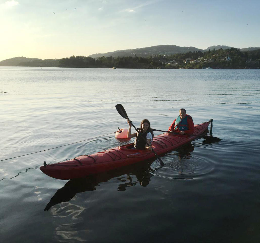 Gayanne and Adrey in a kayak on the fjord.