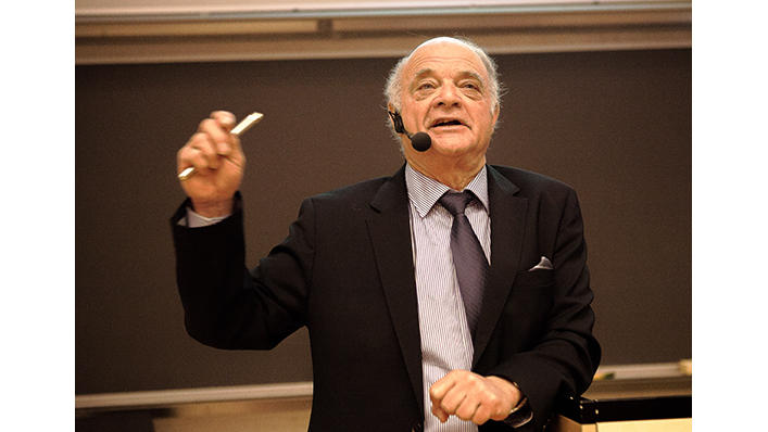 Professor Kerbel holding a lecture in an auditorium