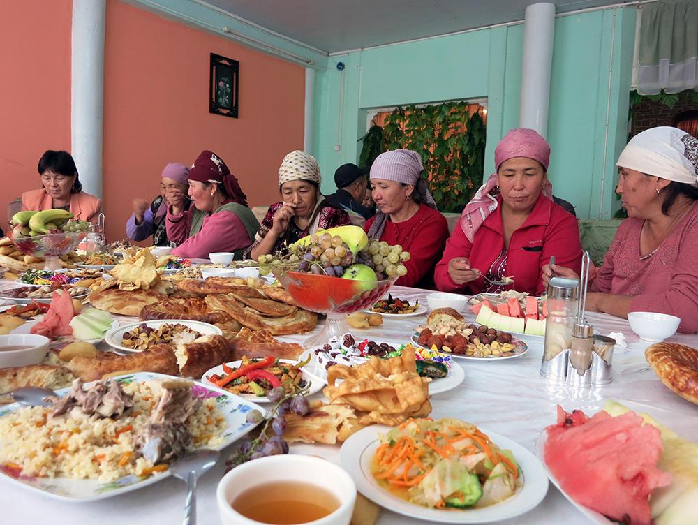 Eight women enjoying a shared meal