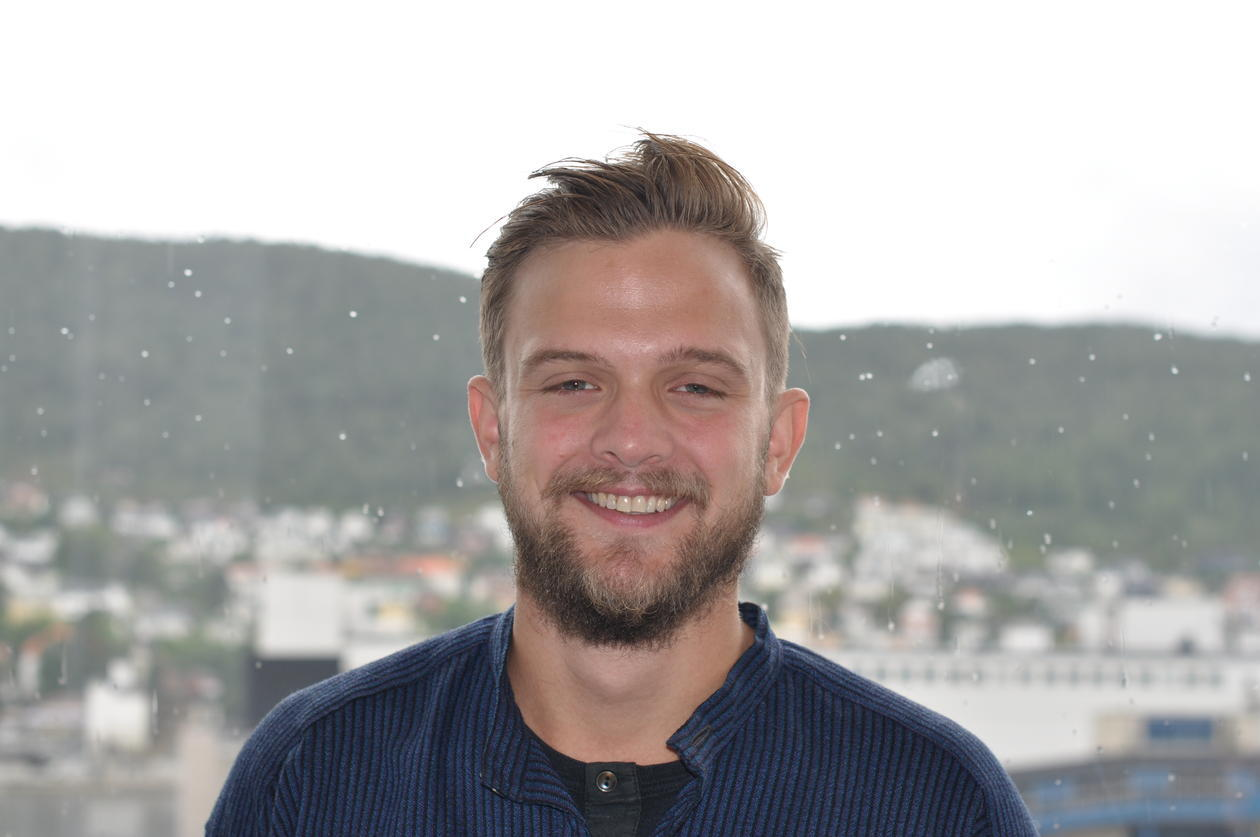 Image of Lauritz Isaksen. He is a white male in his late twenties, with blonde hair and a short beard. He is smiling.