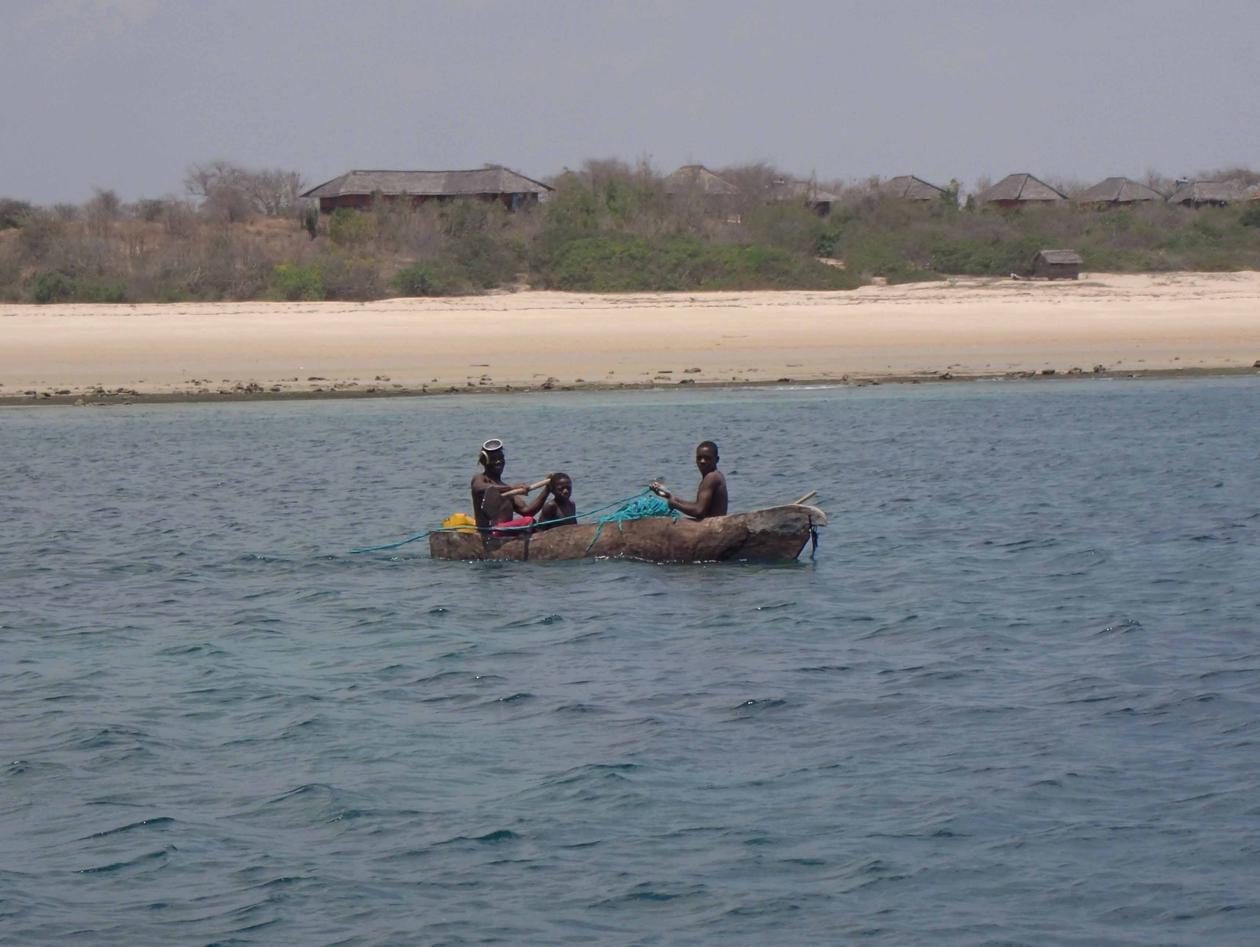Local fishermen in a wooden canoe