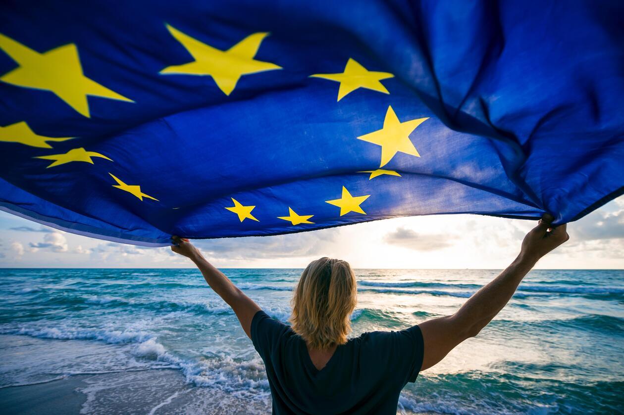 Man holding EU flag
