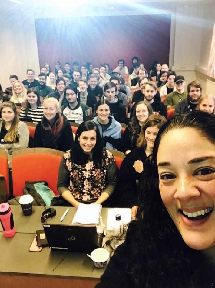 Photo of Mia Zamora with her students in DIKULT103, January 2018.