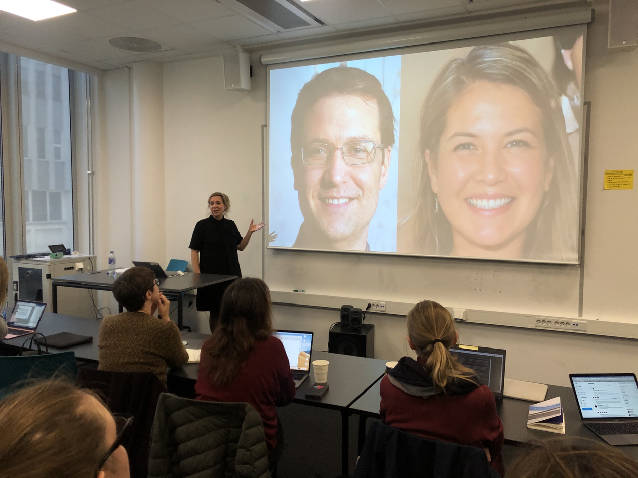 Taina bucher lectures while gesturing at her powerpoint slide displaying two algoritmically created portrait 'photographs'