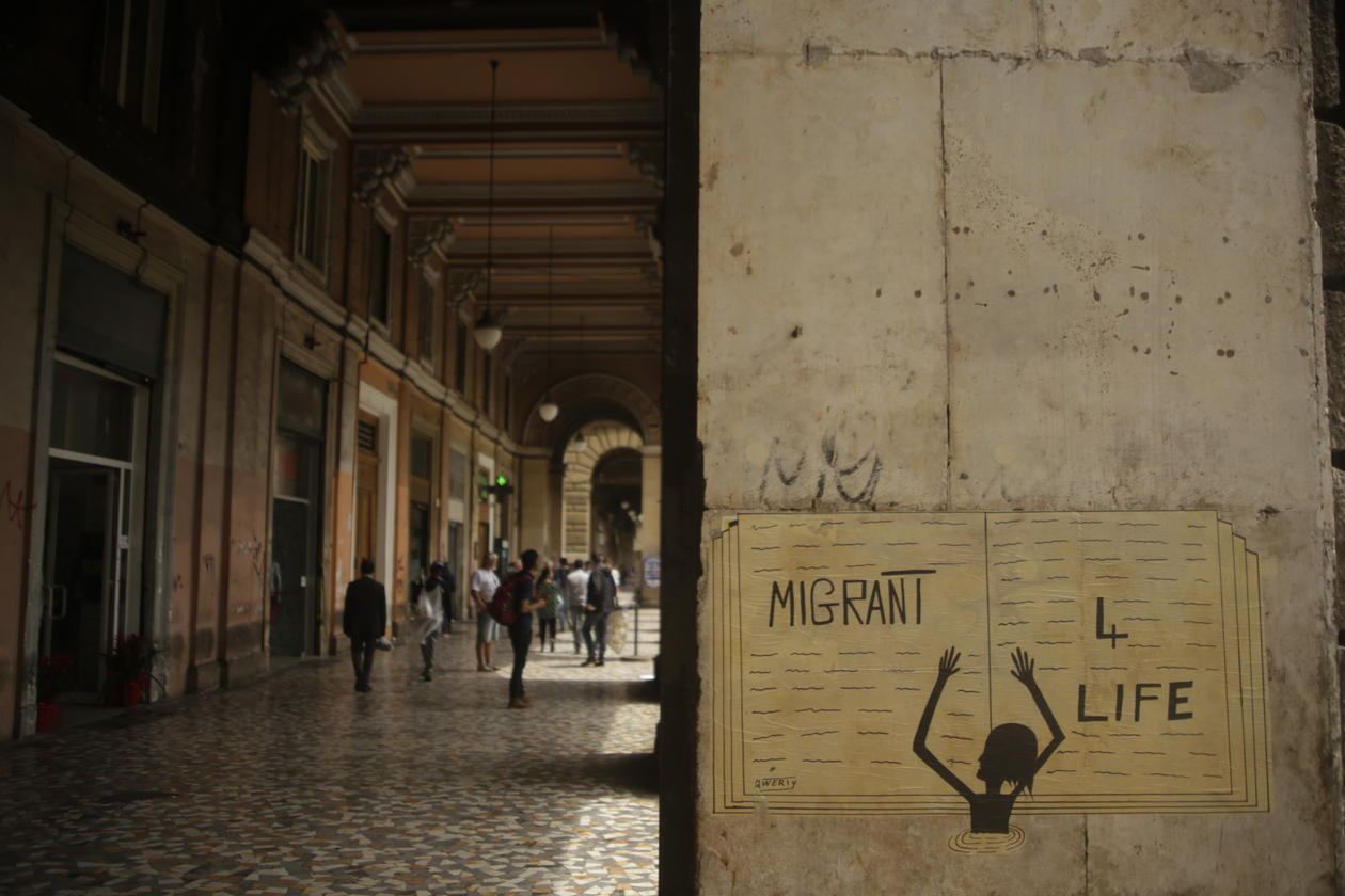 Streetart showing a drowning migrant