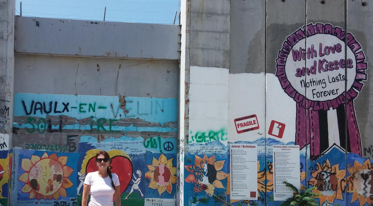 Siv Lise Bedringaas in front of the wall in Bethlehem.