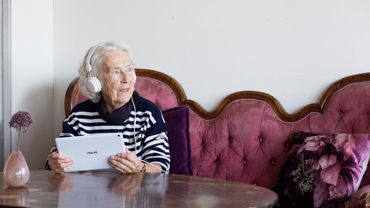 elderly woman using technology