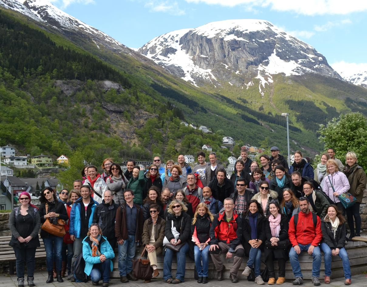 All the participants gathered to get a photo in Odda with snowy mountain in the background.
